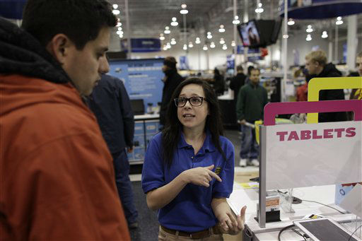 "<div class=""meta image-caption""><div class=""origin-logo origin-image ""><span></span></div><span class=""caption-text"">Best Buy electronics store employee Maddy Cooke, a criminology major in college, helps a customer looking at computers, during a Black Friday sale that started at midnight, in Broomfield, Colo., early Friday Nov. 23, 2012.  (AP Photo/ Brennan Linsley)</span></div>"
