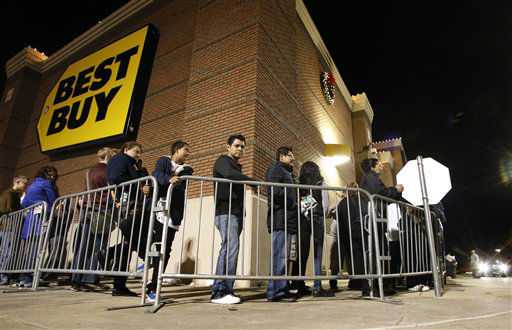 Shoppers stand in a line that wraps around the building at a Best Buy department store waiting for the store&#39;s opening at midnight for Black Friday sales Thursday, Nov. 22, 2012, in Arlington, Texas.  <span class=meta>(AP Photo&#47; Tony Gutierrez)</span>