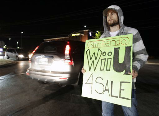 "<div class=""meta ""><span class=""caption-text "">Allan Abbott advertises Nintendo Wii U video games he is selling as shoppers drive by outside a shopping complex on Friday, Nov. 23, 2012, in Franklin, Tenn.  (AP Photo/ Mark Humphrey)</span></div>"