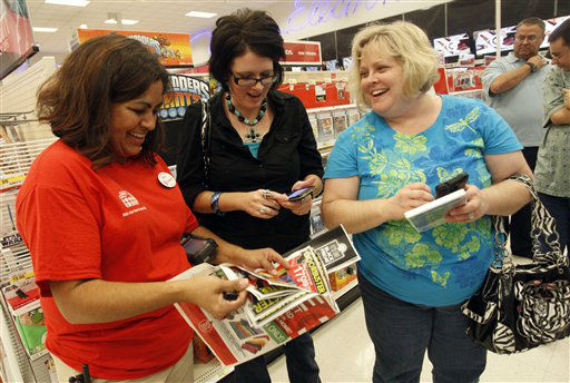 Target team member Melba Breidenstein assists Angela McCrary and Rebecca Freeman during Black Friday shopping on Thursday, November 22, 2012 in Hurst, Texas.