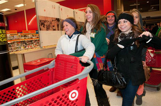"<div class=""meta ""><span class=""caption-text "">Shoppers eager for doorbuster deals enter the Roseville, Minn. Target store Thursday Nov. 22, 2012 for Black Friday shopping.  (AP Photo/ DAWN VILLELLA)</span></div>"