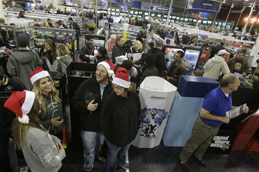 Shoppers, at bottom, right to left, Karin Carlson, of Wichita, Kan., her husband Jason, and her cousins Tylar Neu and Christie LaFever wait in line to pay for items for purchase at Best Buy electronics store, after doors opened for a Black Friday sale that started at midnight, in Broomfield, Colo., early Friday Nov. 23, 2012.  <span class=meta>(AP Photo&#47; Brennan Linsley)</span>