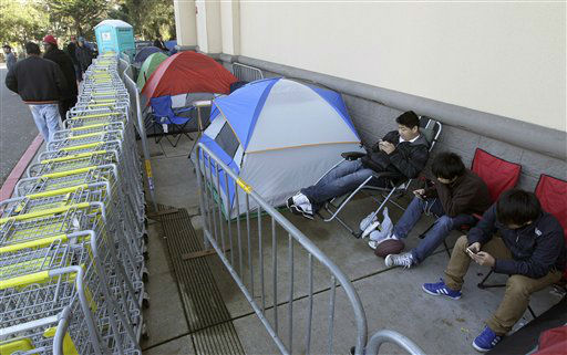 Shoppers wait in line outside of a Best Buy store in Colma, Calif., Thursday, Nov. 22, 2012.  <span class=meta>(AP Photo&#47; Jeff Chiu)</span>