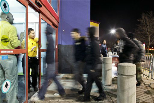 Store employees open the doors at midnight to a Best Buy store, in Northeast Philadelphia on Friday Nov 23, 2012.  <span class=meta>(AP Photo&#47; Joseph Kaczmarek)</span>
