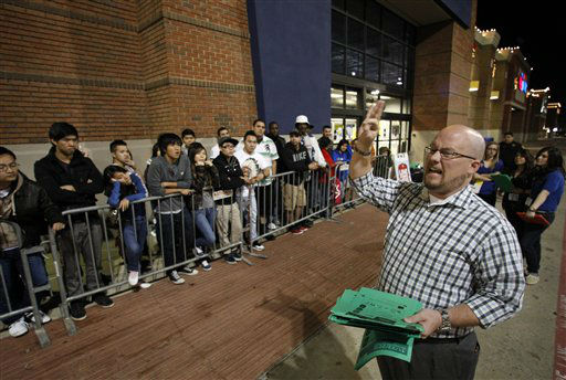 Best Buy general manager Shaun Ogdie, right,  gives instructions to shoppers before handing out  sale vouchers on popular eletronics items before the store opened at midnight Thursday Nov. 22, 2012, in Arlington, Texas.  <span class=meta>(AP Photo&#47; Tony Gutierrz)</span>