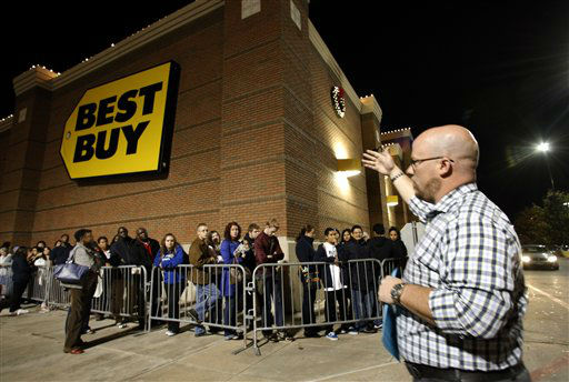 Best Buy general manager Shaun Ogdie, right, gives instructions to shoppers before handing out  sale vouchers on popular electronics items before the store opened at midnight for Black Friday sales Thursday Nov. 22, 2012, in Arlington, Texas. <span class=meta>(AP Photo&#47; Tony Gutierrez)</span>