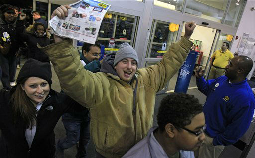 Ray Schwarz, 28, celebrates after waiting 24-hours to enter Best Buy Friday, Nov. 23, 2012, in Mayfield Heights, Ohio. The store opened at 12 a.m. on Friday. Schwarz was buying three televisions, a sound system and video games.  <span class=meta>(AP Photo&#47; Tony Dejak)</span>