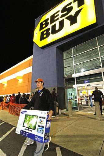"<div class=""meta ""><span class=""caption-text "">Tyler Harless of Byram, Miss., leaves a Jackson, Miss., Best Buy store after making Black Friday purchases early Nov. 23, 2012.  (AP Photo/ Rogelio V. Solis)</span></div>"