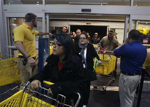 "<div class=""meta ""><span class=""caption-text "">Best Buy electronics store employees, at far right and left, open doors to shoppers for a Black Friday sale that began at midnight, in Broomfield, Colo., early Friday Nov. 23, 2012.  (AP Photo/ Brennan Linsley)</span></div>"