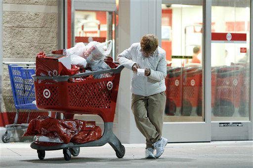 Betsy McGonagle checks her receipt after shopping for Black Friday discounts at a Target store, Friday Nov 23, 2012, in Northeast Philadelphia.