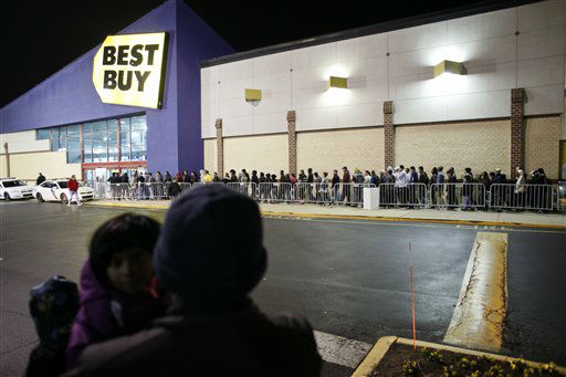 People wait in line, on Thursday Nov 22, 2012,...