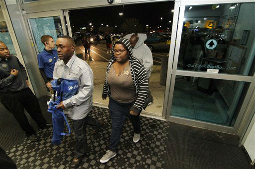 Shoppers rush into a north Jackson, Miss., Best Buy for early sales on Friday, Nov. 23, 2012.