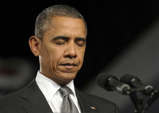 President Barack Obama pauses during a moment of silence for the victims of the Aurora, Colo., shooting during an event at the Harborside Event Center in Ft. Myers, Fla., Friday, July 20, 2012.  <span class=meta>(AP Photo&#47; Susan Walsh)</span>