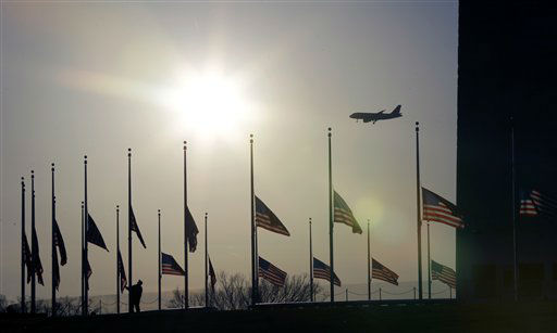 "<div class=""meta image-caption""><div class=""origin-logo origin-image ""><span></span></div><span class=""caption-text"">American flags surrounding the Washington Monument in Washington are lowered to half-staff in a mark of respect for the victims on the Connecticut elementary school shootings, Friday, Dec. 14, 2012.  (AP Photo/ Alex Brandon)</span></div>"