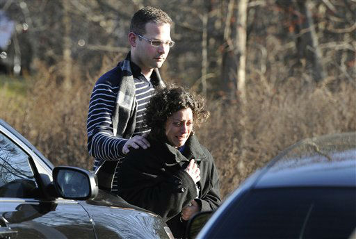 "<div class=""meta image-caption""><div class=""origin-logo origin-image ""><span></span></div><span class=""caption-text"">A man and woman leave the staging area for family around near the scene of a shooting at the Sandy Hook Elementary School in Newtown, Conn., about 60 miles northeast of New York City, Friday, Dec. 14, 2012.  (AP Photo/ Jessica Hill)</span></div>"