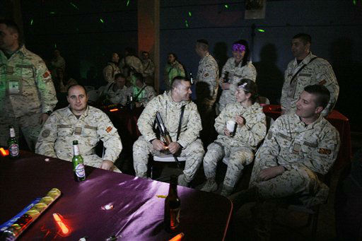 Soldiers with the NATO led International Security Assistance Force (ISAF) attend at a New Year eve celebration at the NATO's headquarters in Kabul, Afghanistan, Monday, Dec. 31, 2012.