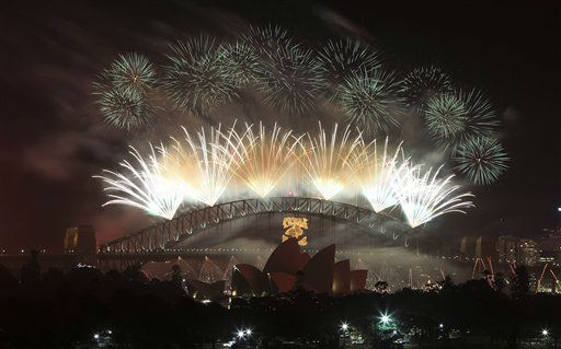Fireworks explode in the sky above Sydney...