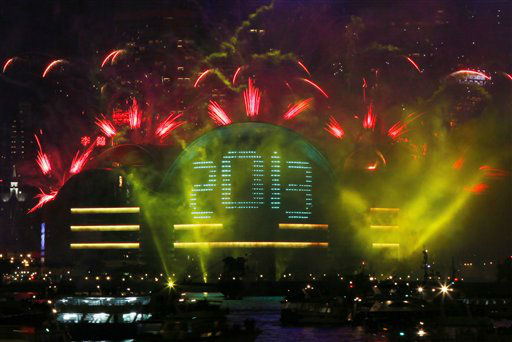 "<div class=""meta image-caption""><div class=""origin-logo origin-image ""><span></span></div><span class=""caption-text"">Fireworks explode in front of the Hong Kong Convention and Exhibition Centre over the Victoria Harbor as celebrating the 2013 New Year in Hong Kong Tuesday, Jan. 1, 2013. (AP Photo/ Kin Cheung)</span></div>"
