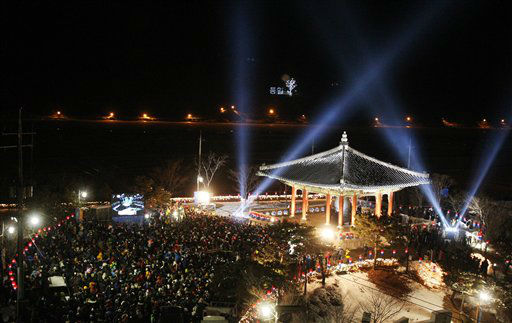 People gather to celebrate the New Year at Imjingak in Paju near the border village of the Panmunjom, South Korea, Tuesday, Jan. 1, 2013.