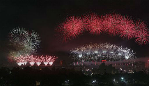 "<div class=""meta ""><span class=""caption-text "">Fireworks explode in the sky above Sydney Harbour during the New Year celebrations in Sydney, Australia, Tuesday, Jan. 1, 2013. (AP Photo/ Rob Griffith)</span></div>"