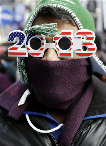 Pranav Patel of Toronto, is bundled up as he waits Monday morning, Dec. 31, 2012 for midnight in Times Square in New York, Monday, Dec. 31, 2012.