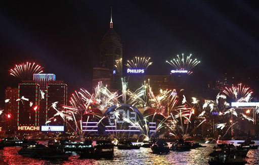 Fireworks explode in front of the Hong Kong Convention and Exhibition Centre over the Victoria Harbor as celebrating the 2013 New Year in Hong Kong Tuesday, Jan. 1, 2013. <span class=meta>(AP Photo&#47; Kin Cheung)</span>