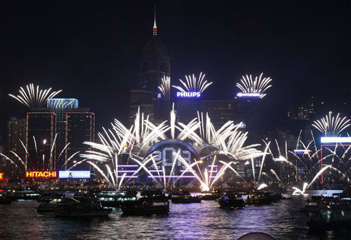 Fireworks explode at the Hong Kong Convention and Exhibition Centre over the Victoria Har