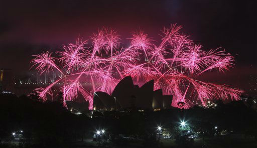 "<div class=""meta ""><span class=""caption-text "">Fireworks explode behind the Opera House during the New Year celebrations in Sydney, Australia, Tuesday, Jan. 1, 2013. (AP Photo/ Rob Griffith)</span></div>"