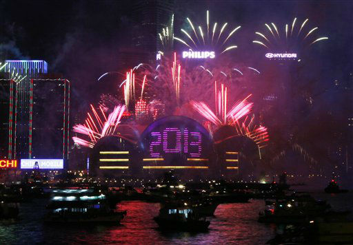 Fireworks explode at the Hong Kong Convention and Exhibition Centre over the Victoria Harbor as celebrating the 2013 New Year in Hong Kong Tuesday, Jan. 1, 2013. <span class=meta>(AP Photo&#47; Kin Cheung)</span>