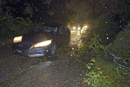 A car tries to navigate down a street littered with downed tree limbs and other debris after a tornado touched down Tuesday, Dec. 25, 2012 in the Midtown area of Mobile, Ala.  <span class=meta>(AP Photo&#47; G.M. Andrews)</span>