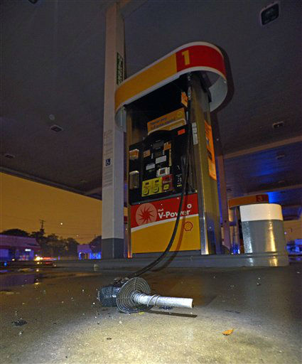 The nozzle of a gasoline pump sits on the ground after being blown from its pump after a tornado touched down Tuesday, Dec. 25, 2012 in Mobile, Ala.  <span class=meta>(AP Photo&#47; G.M. Andrews)</span>
