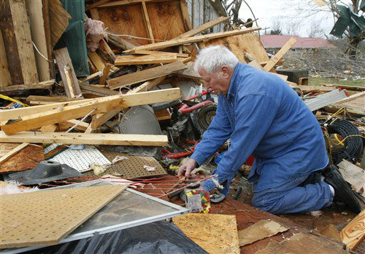 Ronnie Shanes searches through debris of his brother&#39;s home after a storm ripped through Coble, Tenn. early Wednesday, Jan. 30, 2013. A large storm system packing high winds, hail and at least one tornado tore across a wide swath of the South and Midwest on Wednesday, killing one person, blacking out power to thousands and damaging homes.  <span class=meta>(AP Photo&#47; Butch Dill)</span>