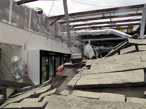 "<div class=""meta ""><span class=""caption-text "">The wall of a Dollar General store in Mount Juliet, Tenn., is collapsed and the roof was torn off during severe storms on Wednesday, Jan. 30, 2013.  Forecasters examined the damage path of 4.6 miles Wednesday morning and estimated the peak wind speed at 115 mph, qualifying the tornado as an EF-2 twister. The path of damage was about 150 yards wide.  (AP Photo/ Kristin M. Hall)</span></div>"