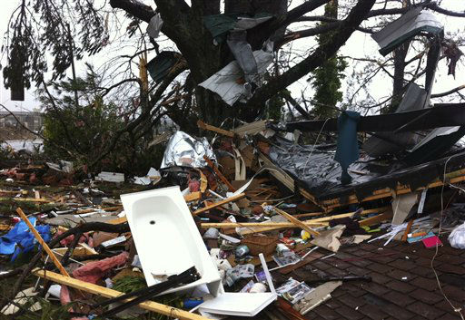 "<div class=""meta image-caption""><div class=""origin-logo origin-image ""><span></span></div><span class=""caption-text"">Debris lies on yard after a tornado moved through  Adairsville, Ga. Wednesday, Jan. 30, 2013. A fierce storm system that roared across northwest Georgia has left at least one person dead and a trail of damage that included demolished buildings in downtown Adairsville and vehicles overturned on Interstate 75 northwest of Atlanta.  A tornado touched down in Adairsville, and authorities confirmed that at least one person was killed in the town about 60 miles northwest of Atlanta. (AP Photo/ David Goldman)</span></div>"