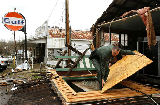 Hickman County Sheriff, Cody Woods helps remove debris from a house after a storm ripped through early morning on Wednesday, Jan. 30, 2013, in Coble, Tenn.   A line of strong storms is pushing eastward across Tennessee, triggering tornado warnings and producing strong downpours of rain.  <span class=meta>(AP Photo&#47; Butch Dill)</span>