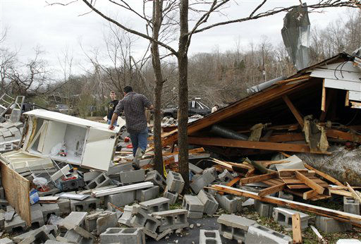 Residents search through debris after a suspected tornado ripped through early morning destroying several homes and businesses on Wednesday, Jan. 30, 2013, in Coble, Tenn. <span class=meta>(AP Photo&#47; Butch Dill)</span>