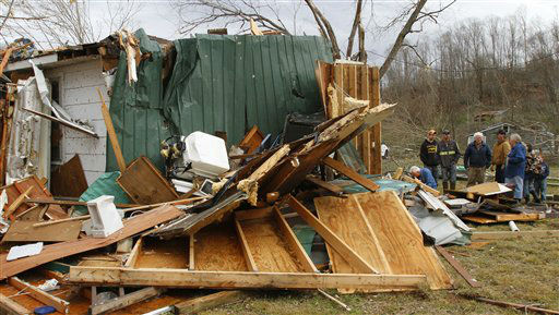 "<div class=""meta ""><span class=""caption-text "">The Shanes family searches through debris of their families home after a tornado ripped through early  Wednesday morning Jan. 30,2013, destroying several homes and businesses in Coble, Tenn.  (AP Photo/ Butch Dill)</span></div>"
