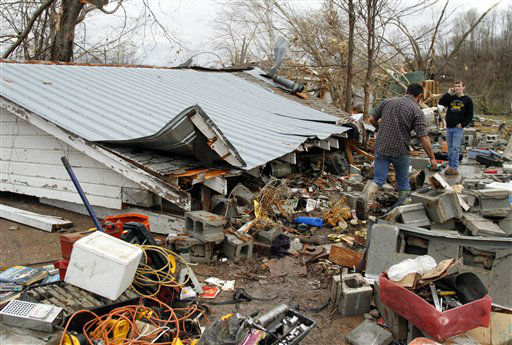 Residents search through debris after a storm ripped through Coble, Tenn. early Wednesday, Jan. 30, 2013. A large storm system packing high winds, hail and at least one tornado tore across a wide swath of the South and Midwest on Wednesday, killing one person, blacking out power to thousands and damaging homes. <span class=meta>(AP Photo&#47; Butch Dill)</span>