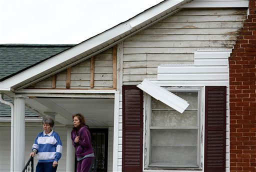 Jean Fogus, left, and her daughter Pamela Luna stand on there porch after tornado touched down damaging the siding, uprooted a tree and knocked out power to there home along Batson Drive Wednesday, Jan. 30, 2013, in Ashland City, Tenn.  <span class=meta>(AP Photo&#47; Mark Zaleski)</span>
