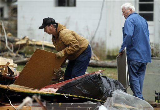 Barry Shanes, left, and Ronnie Shanes search through debris of a relatives home after a storm ripped through Coble, Tenn. early Wednesday, Jan. 30, 2013. A large storm system packing high winds, hail and at least one tornado tore across a wide swath of the South and Midwest on Wednesday, killing one person, blacking out power to thousands and damaging homes.  <span class=meta>(AP Photo&#47; Butch Dill)</span>