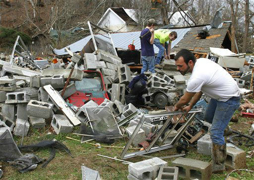 Justin Chandler searches through debris of his brother-n-law&#39;s shop after a tornado ripped through early Wednesdy morning Jan. 30, 2013, destroying several homes and businesses  in Coble, Tenn. <span class=meta>(AP Photo&#47; Butch Dill)</span>