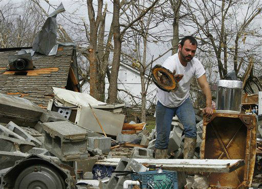 "<div class=""meta image-caption""><div class=""origin-logo origin-image ""><span></span></div><span class=""caption-text"">Justin Chandler searches through debris of his brother-n-law's shop after a storm ripped through Coble, Tenn. early Wednesday, Jan. 30, 2013. A large storm system packing high winds, hail and at least one tornado tore across a wide swath of the South and Midwest on Wednesday, killing one person, blacking out power to thousands and damaging homes.  (AP Photo/ Butch Dill)</span></div>"