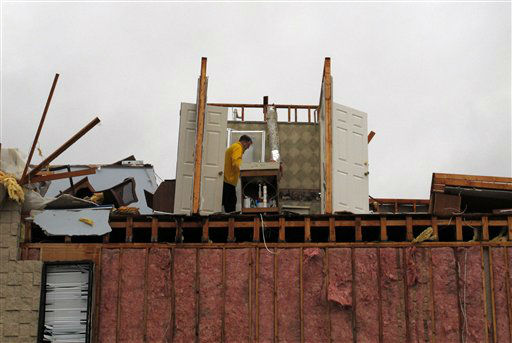 A man inspects damage to the third floor of a building in Mount Juliet, Tenn., that was severely damaged in a severe storm on Wednesday, Jan. 30, 2013.  Forecasters examined the damage path of 4.6 miles Wednesday morning and estimated the peak wind speed at 115 mph, qualifying the tornado as an EF-2 twister. The path of damage was about 150 yards wide.  <span class=meta>(AP Photo&#47; Kristin M. Hall)</span>