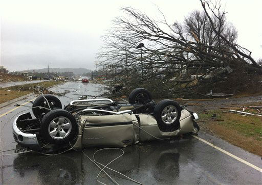 A vehicle lies on a road after a tornado moved through Adairsville, Ga. on Wednesday, Jan. 30, 2013. A fierce storm system that roared across northwest Georgia has left at least one person dead and a trail of damage that included demolished buildings in downtown Adairsville and vehicles overturned on Interstate 75 northwest of Atlanta.  <span class=meta>(AP Photo&#47; David Goldman)</span>