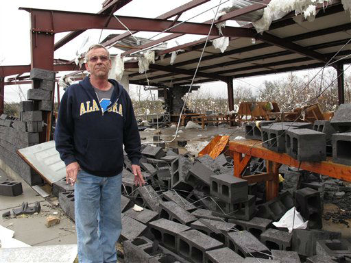 Rick Martin stands in front of a Tennessean newspaper distribution center in Mount Juliet, Tenn., on Wednesday, Jan. 30, 2013, that was destroyed in a severe storm. Forecasters examined the damage path of 4.6 miles Wednesday morning and estimated the peak wind speed at 115 mph, qualifying the tornado as an EF-2 twister. The path of damage was about 150 yards wide. <span class=meta>(AP Photo&#47; Kristin M. Hall)</span>