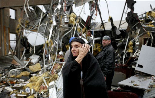 Pam Parker sifts through debris while looking for any personal belongings in the area where she was sitting at her desk when a tornado struck the Daiki plant, a metal fabrication company where she works in accounts payable, Wednesday, Jan. 30, 2013, in Adairsville, Ga.  <span class=meta>(AP Photo&#47; David Goldman)</span>
