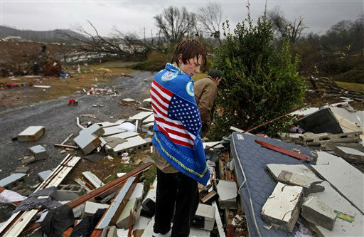 Will Carter, 15, wraps himself up in a towel he found while searching debris for the family dog, a pit bull named Niko, upon arriving to his damaged home from school following a tornado, Wednesday, Jan. 30, 2013, in Adairsville, Ga. A fierce storm system that roared across Georgia has left at least one person dead after it demolished buildings and flipped vehicles on Interstate 75 northwest of Atlanta.  <span class=meta>(AP Photo&#47; David Goldman)</span>