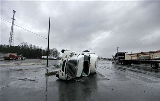 An overturned tractor trailer sits in a parking lot following a tornado, Wednesday, Jan. 30, 2013, in Adairsville, Ga. A fierce storm system that roared across Georgia has left at least one person dead after it demolished buildings and flipped vehicles on Interstate 75 northwest of Atlanta.  <span class=meta>(AP Photo&#47; David Goldman)</span>