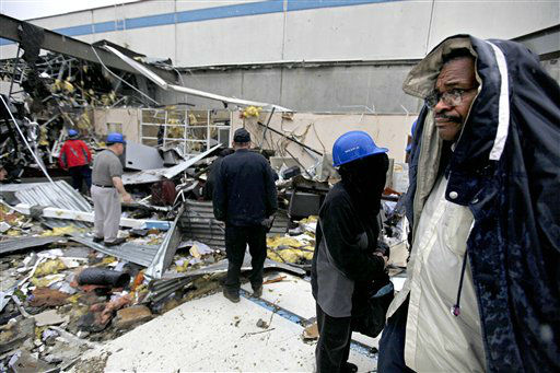 "<div class=""meta ""><span class=""caption-text "">Workers look for the personal belongings following a tornado at the Daiki plant, a metal fabrication company, Wednesday, Jan. 30, 2013, in Adairsville, Ga. A fierce storm system that roared across Georgia has left at least one person dead after it demolished buildings and flipped vehicles on Interstate 75 northwest of Atlanta.  (AP Photo/ David Goldman)</span></div>"