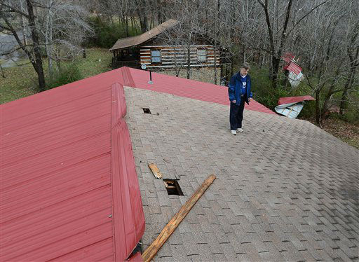 John Heinrich inspects the damage to his home after a tornado ripped a section of his tin roof off Wednesday, Jan. 30, 2013, in Ashland City, Tenn.  <span class=meta>(AP Photo&#47; Mark Zaleski)</span>